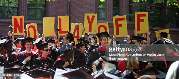 Harvard Law Students hold up a sign asking for No Layoffs after they are conferred at the Harvard University Commencement in Harvard Yard. Saved in...