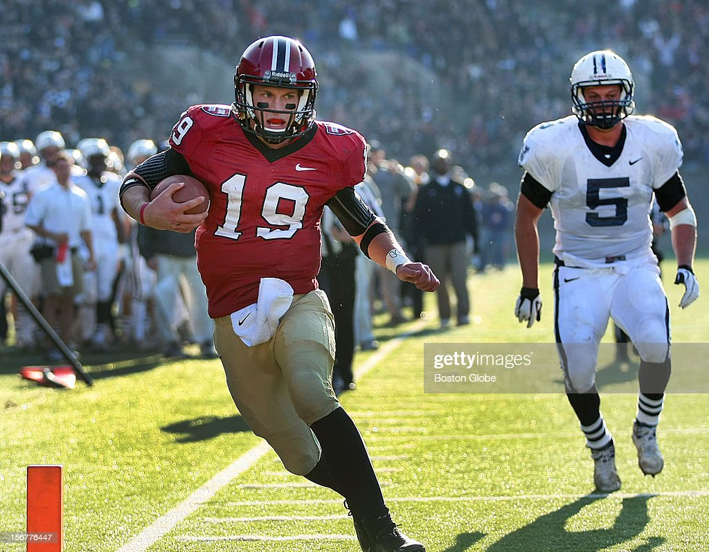 Harvard quarterback Colton Chapple scores a third quarter touchdown putting Harvard ahead 12-3 as Harvard University hosts Yale University during their annual game, Nov. 17, 2012 at Harvard Stadium. Yale's Will Mchale couldn't catch him.
