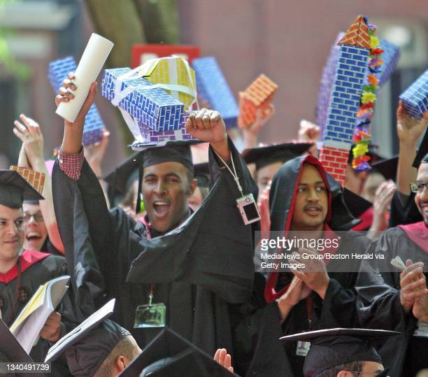 Harvard School of Design students celebrate with their big mortar boards after being conferred at the Harvard University Commencement in Harvard...
