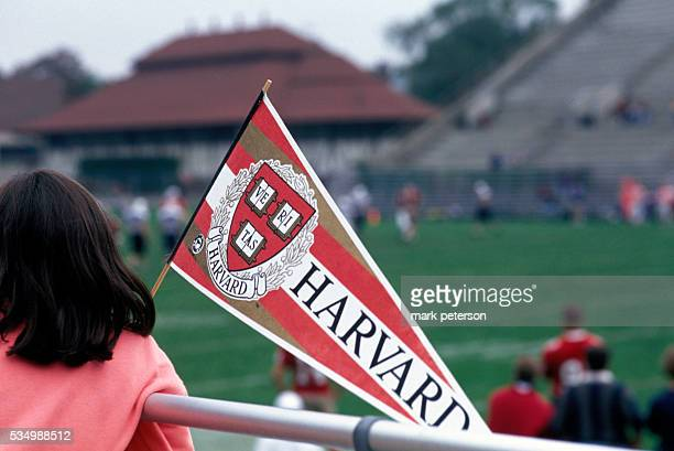 Harvard students and alumnae attend a Harvard football game. --- Photo by Mark Peterson/Corbis SABA