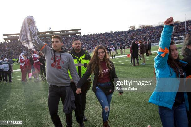 Harvard students are arrested after the protest during the halftime of the college football game between Harvard and Yale at the Yale Bowl in New...