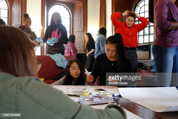 Harvard students gather in the Phillip Brooks House to make signs for a march planned for the following day in support of affirmative action in...