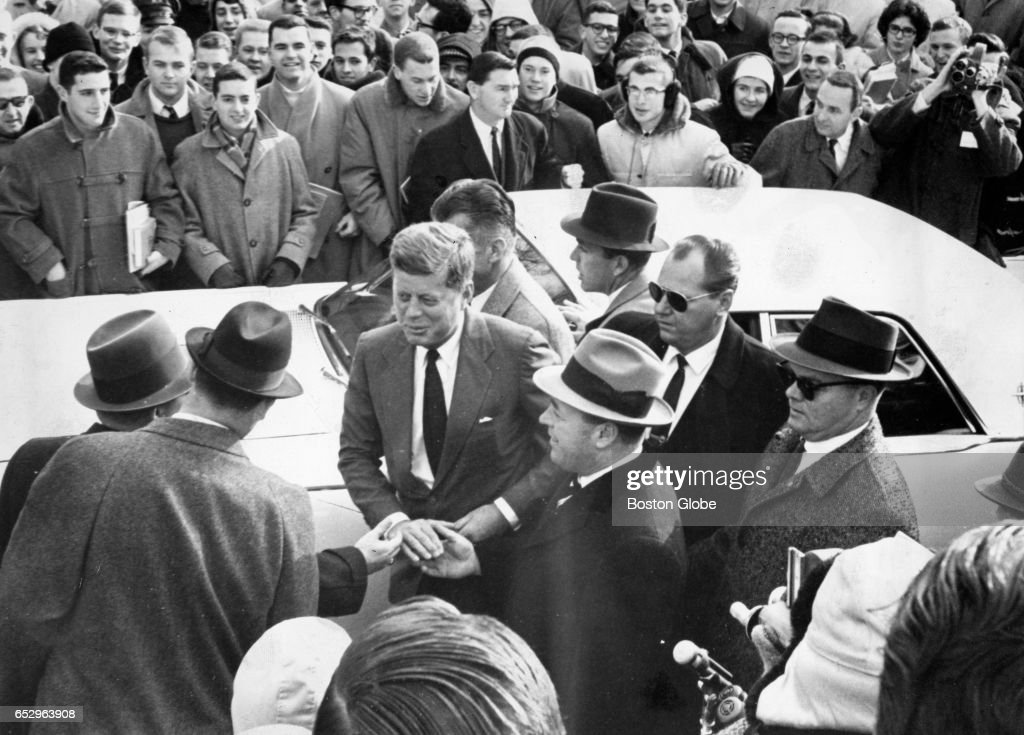 Harvard Students gather to welcome President-elect John F. Kennedy as he arrives at the university in Cambridge, MA for a visit as a member of the board of overseers on Jan. 9, 1961.