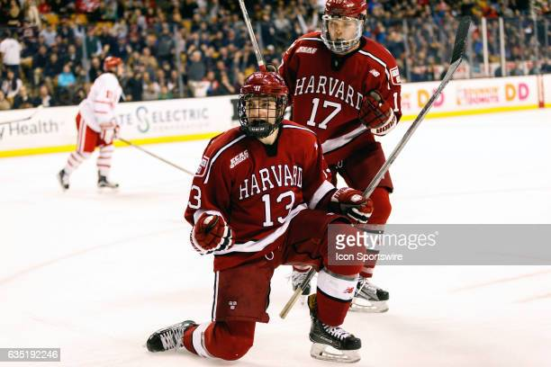 Harvard University Crimson forwards Nathan Krusko and Sean Malone celebrate a goal by Krusko during the second period of the Beanpot Tournament...