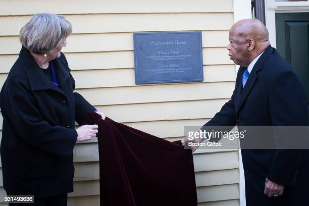Harvard University President Drew Gilpin Faust left and Congressman John Lewis unveil a plaque at Harvard's Wadsworth House honoring four slaves that...