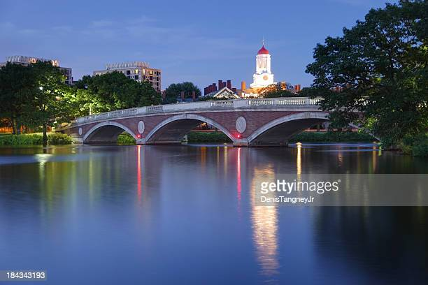 harvard university reflecting on the charles river - harvard university stock pictures, royalty-free photos & images