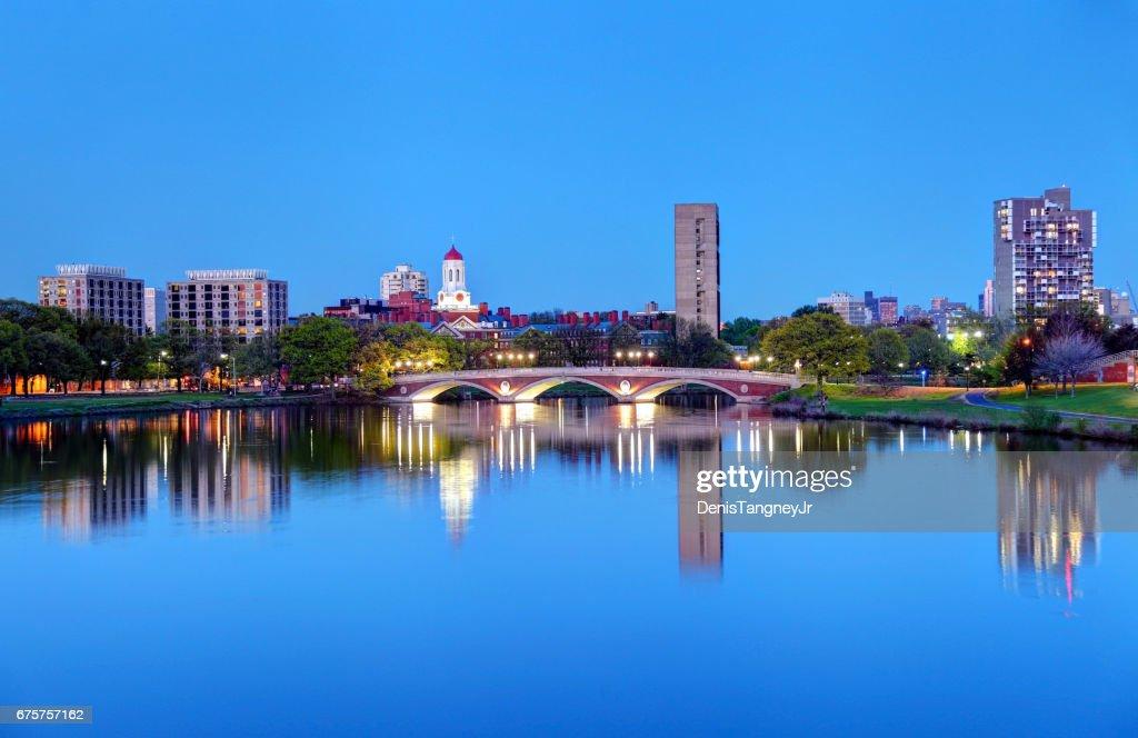 Harvard University reflecting on the Charles River : Stock Photo