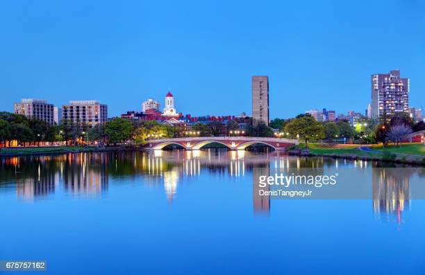 harvard university reflecting on the charles river - massachusetts stock pictures, royalty-free photos & images
