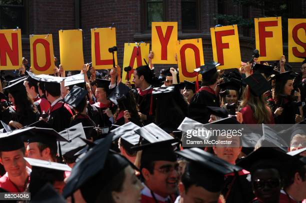 Harvard University students from the Kennedy School of Government hold up a sign during commencement ceremonies June 4 2009 in Harvard Yard in...