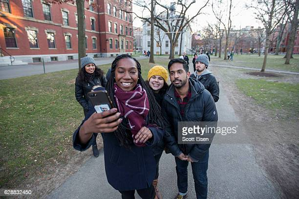 Harvard University students Kayla Evans left and Jerry Nelluvelil right post on Snapchat with Get Schooled College Tour Contest Winner Patricia...