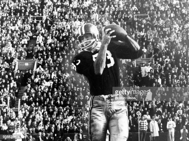 Harvard University's Bruce Freeman catches a touchdown pass during the second quarter of of The Game against Yale University at Harvard Stadium in...