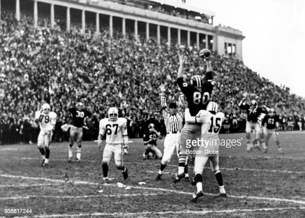 Harvard University's Pete Varney shows the football he just caught for two points after time ran out to tie the game against Yale University on Nov...
