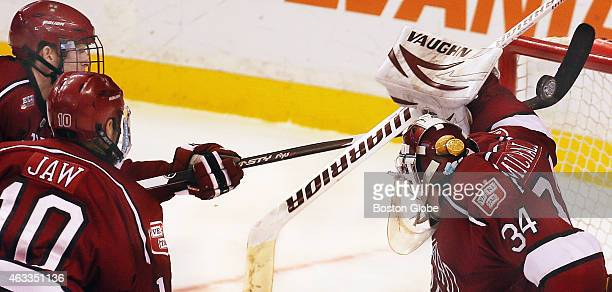 Harvard's Eddie Ellis a freshman from Burlington Mass makes an unusual stick save after the puck got by Harvard goalie Steve Michalek Boston...