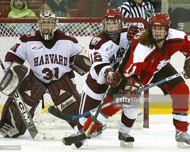 Harvard's goalie Ali Boe forward Lindsay Weaver and St Lawrence's Crystal Connors watch the action from the crease Saturday February 21 in Cambridge...