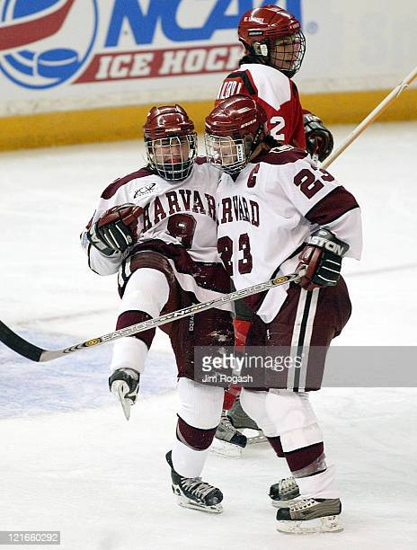 Harvard's Nicole Corriero and Lauren McAuliffe celebrate after Corriero scored the first goal against St. Lawrence during the NCAA 2004 Women's...