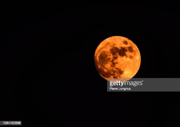 harvest moon - orange moon - harvest moon stock pictures, royalty-free photos & images