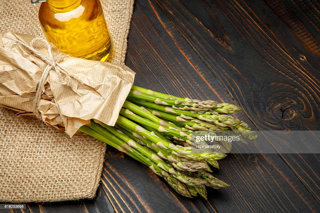 harvested asparagus on wooden : Stock Photo