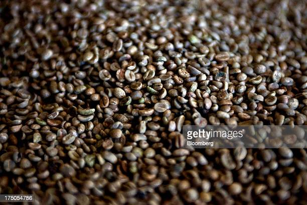 Harvested coffee sit in a storage area at the Japy grain house and silo complex belonging to the Cooxupe cooperative in the Minas Gerais state in...