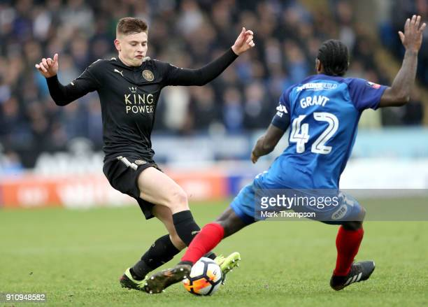 Harvey Barnes of Leicester City and Anthony Grant of Peterborough United battle for possession during The Emirates FA Cup Fourth Round match between...