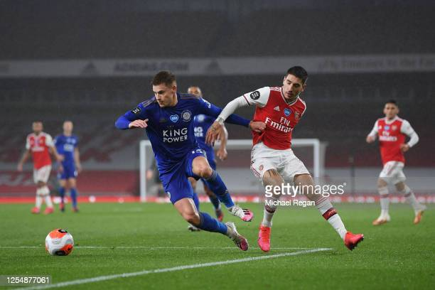 Harvey Barnes of Leicester City and Hector Bellerin of Arsenal battle for the ball during the Premier League match between Arsenal FC and Leicester...