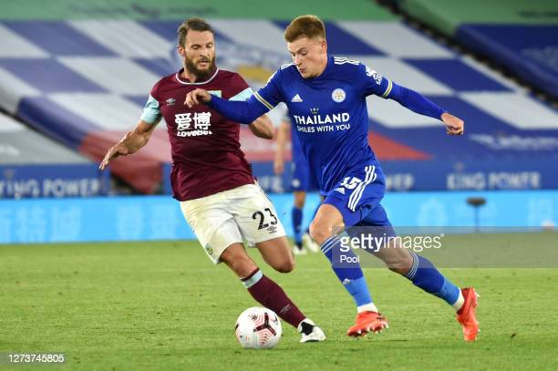 Harvey Barnes of Leicester City battles for possession with Erik Pieters of Burnley during the Premier League match between Leicester City and...