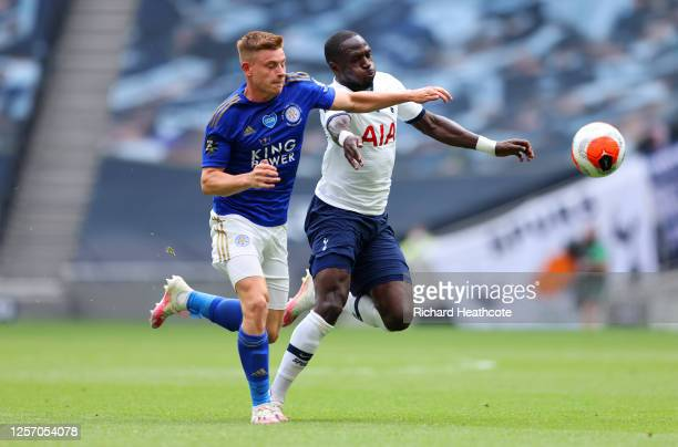 Harvey Barnes of Leicester City battles for possession with Moussa Sissoko of Tottenham Hotspur during the Premier League match between Tottenham...