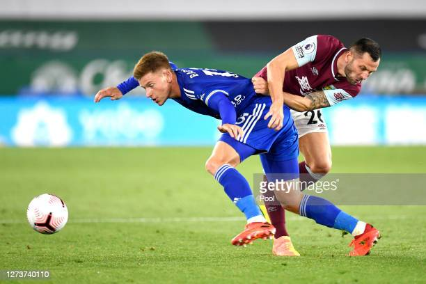Harvey Barnes of Leicester City battles for possession with Phil Bardsley of Burnley during the Premier League match between Leicester City and...