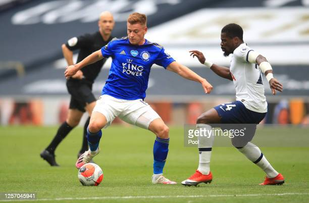 Harvey Barnes of Leicester City battles for possession with Serge Aurier of Tottenham Hotspur during the Premier League match between Tottenham...