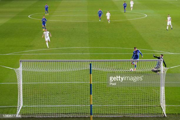 Harvey Barnes of Leicester City beats Illan Meslier of Leeds United to score his team's first goal during the Premier League match between Leeds...