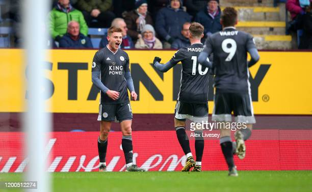 Harvey Barnes of Leicester City celebrates with James Maddison and Jamie Vardy after scoring his team's first goal during the Premier League match...