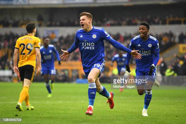 Harvey Barnes of Leicester City celebrates with teammate Demarai Gray after scoring his teams second goal during the Premier League match between...