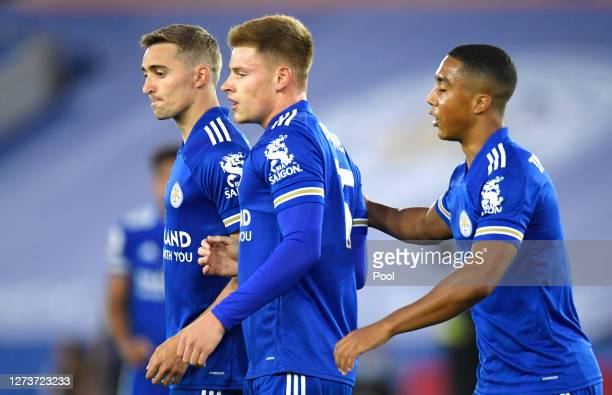 Harvey Barnes of Leicester City celebrates with teammate Timothy Castagne after scoring his team's first goal during the Premier League match between...