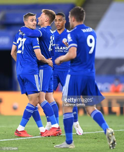 Harvey Barnes of Leicester City celebrates with teammates after scoring his team's first goal during the Premier League match between Leicester City...