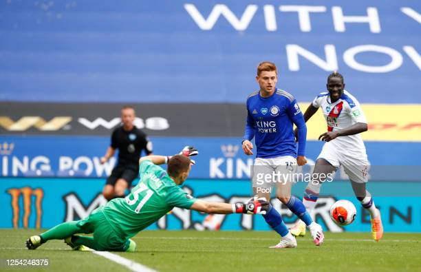 Harvey Barnes of Leicester City crosses the ball to team mate Jamie Vardy leading to their team's second goal during the Premier League match between...
