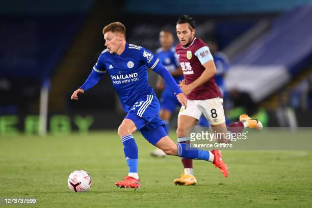 Harvey Barnes of Leicester City goes past Josh Brownhill of Burnley during the Premier League match between Leicester City and Burnley at The King...