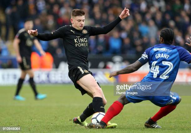 Harvey Barnes of Leicester City in action with Anthony Grant of Peterborough United during The Emirates FA Cup Fourth Round tie between Peterborough...