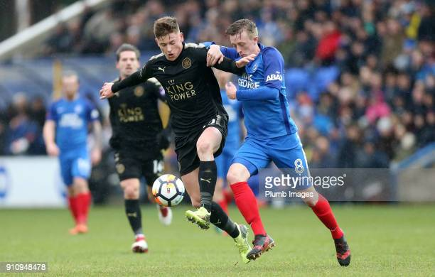 Harvey Barnes of Leicester City in action with Chris Forrester of Peterborough United during The Emirates FA Cup Fourth Round tie between...