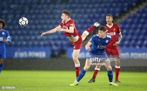 Harvey Barnes of Leicester City in action with Tony Gallacher of Liverpool during the Premier League 2 match between Leicester City and Liverpool at...