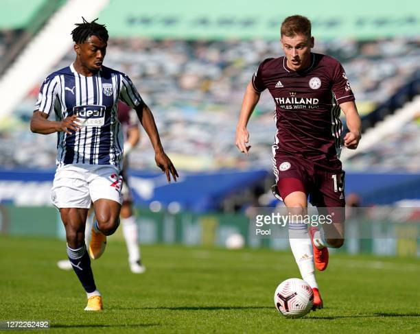 Harvey Barnes of Leicester City is challenged by Kyle Edwards of West Bromwich Albion during the Premier League match between West Bromwich Albion...