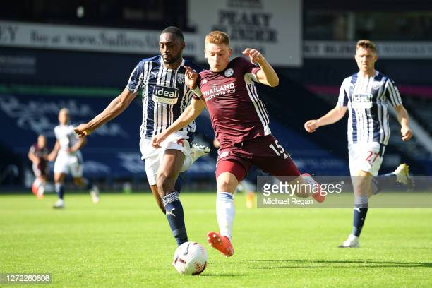 Harvey Barnes of Leicester City is challenged by Semi Ajayi of West Bromwich Albion during the Premier League match between West Bromwich Albion and...