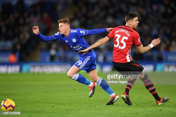 Harvey Barnes of Leicester City runs with the ball past Jan Bednarek of Southampton during the Premier League match between Leicester City and...