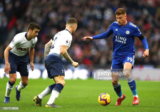 Harvey Barnes of Leicester City runs with the ball under pressure from Kieran Trippier and Harry Winks of Tottenham Hotspur during the Premier League...