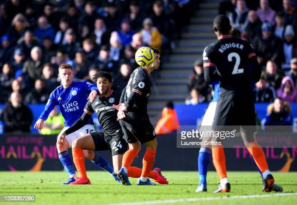 Harvey Barnes of Leicester City scores his team's first goal while under pressure from Reece James of Chelsea during the Premier League match between...