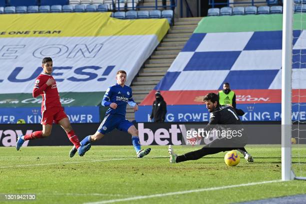 Harvey Barnes of Leicester City scores his team's third goal past Alisson of Liverpool during the Premier League match between Leicester City and...