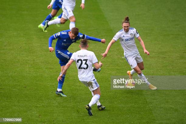 Harvey Barnes of Leicester City scores their side's first goal whilst under pressure from Kalvin Phillips and Luke Ayling of Leeds United during the...