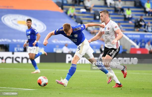 Harvey Barnes of Leicester City shoots under pressure from Jack O'Connell of Sheffield United during the Premier League match between Leicester City...