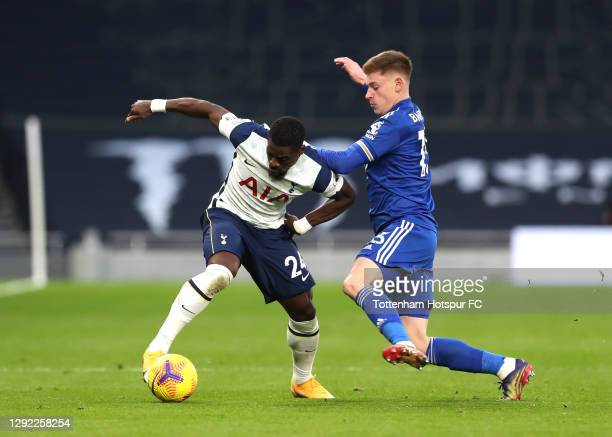 Harvey Barnes of Leicester City tackles Serge Aurier of Tottenham Hotspur during the Premier League match between Tottenham Hotspur and Leicester...