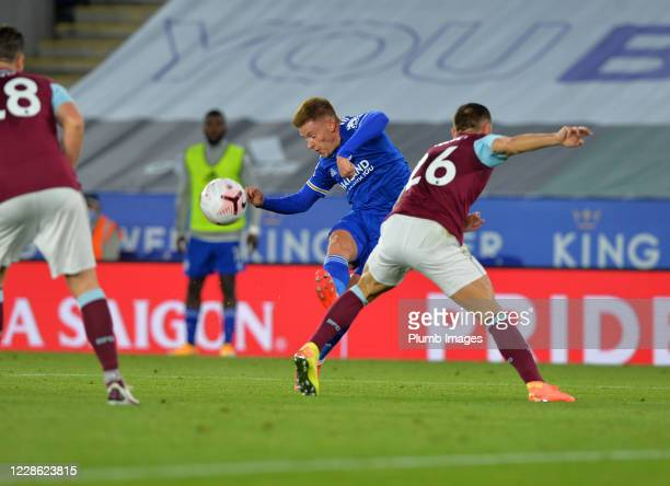 Harvey Barnes of Leicester City tries to get a shot away under pressure from Phil Bardsley of Burnley during the Premier League match between...
