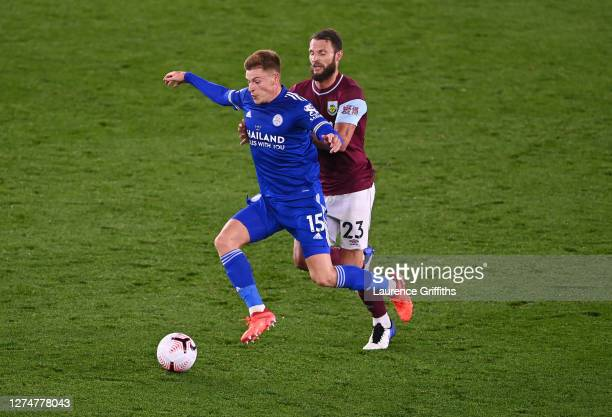 Harvey Barnes of Leicester is tackled by Erik Pieters of Burnley during the Premier League match between Leicester City and Burnley at The King Power...