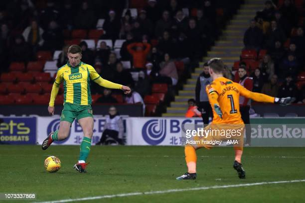 Harvey Barnes of West Bromwich Albion and Dean Henderson of Sheffield United during the Sky Bet Championship match between Sheffield United and West...